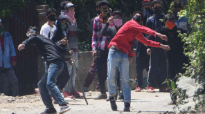 Clashes between protesters and security forces near polling booth at Murran in Pulwama
