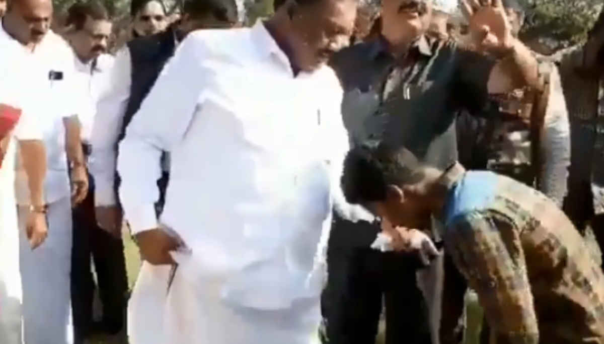 Forest Minister Dindigul Sreenivaasan Asking the Tribal Boy to Unlock his Slipper Buckle