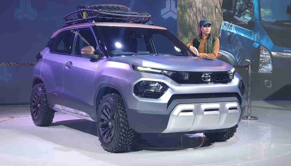Young Model Standing Near The Porduct at the Auto Expo 2020
