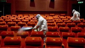 PVR Cinemas employees sanitizing the cinema hall