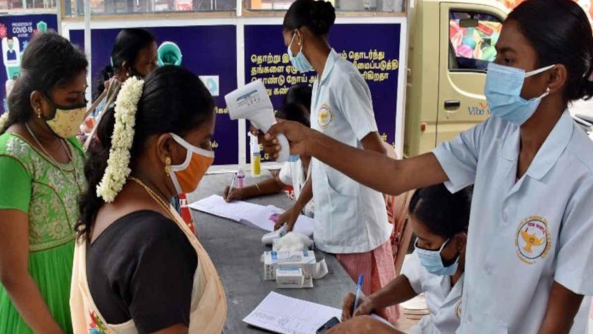 Health staff screening travellers at a coronavirus camp in Gandhipuram bus stand in Coimbatore.