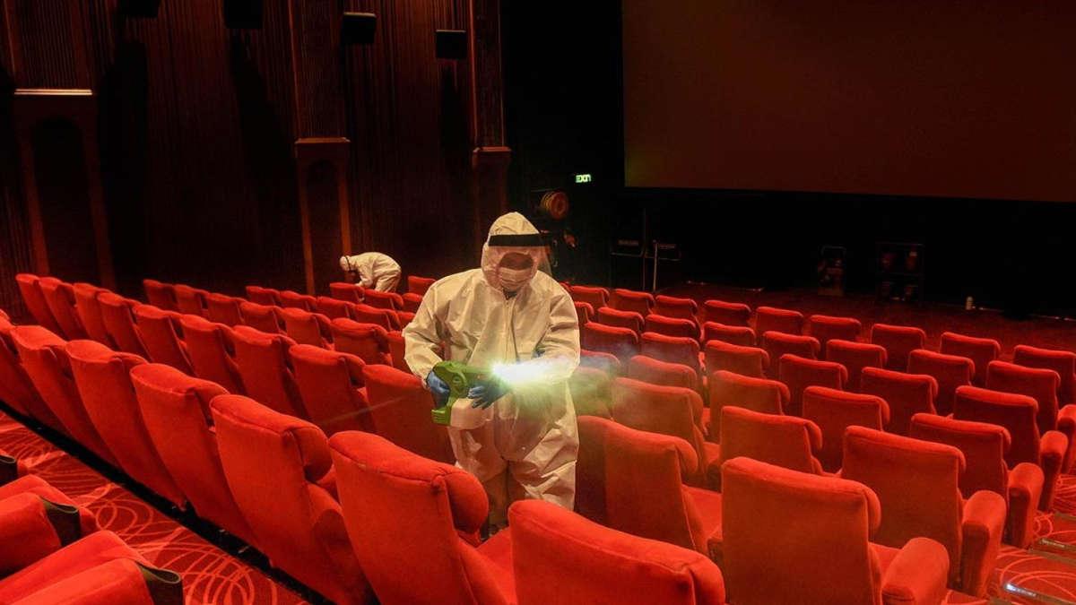 Employees sanitizing the cinema hall