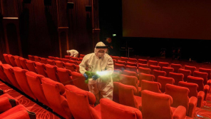 Employees sanitizing the cinema hall